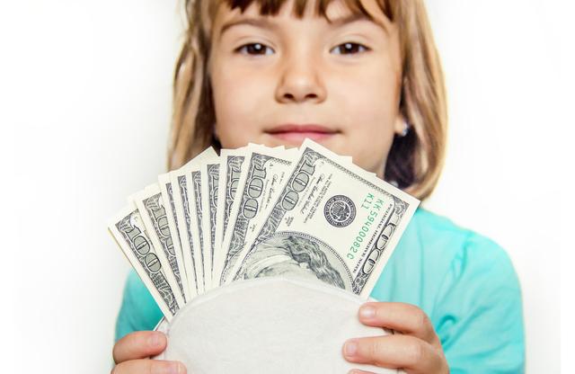 お金を持った子供