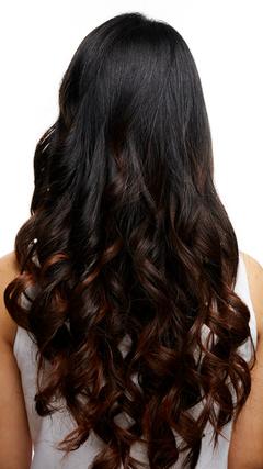 巻髪の女性